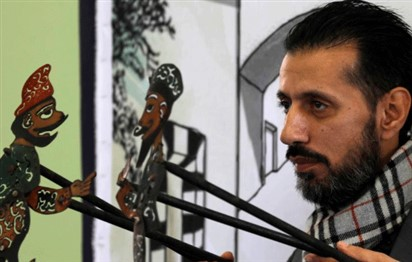 Syria's last shadow puppeteer hopes to save his art