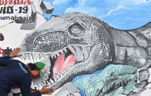 Indonesian artists make wall murals to help clamp down a surging tide of coronavirus infections