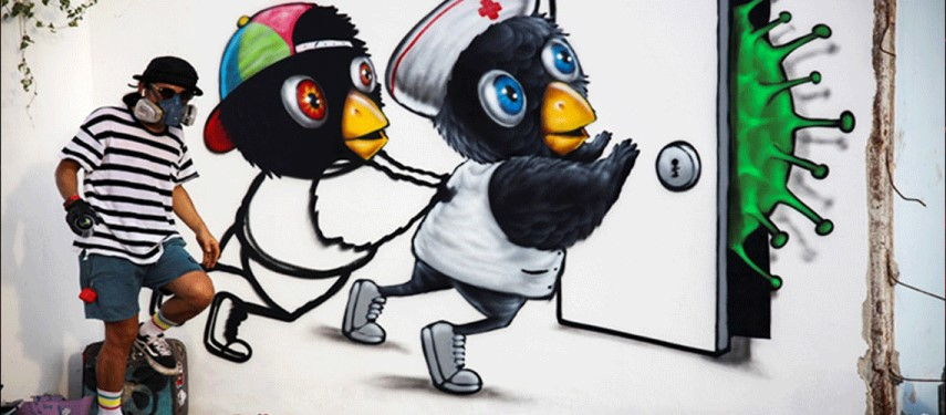 Thai artist, Mue Bon, takes coronavirus battle to the streets by making murals depicting health workers
